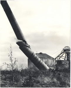 Photograph of chimney being demolished at Woodhorn Colliery in the 1980s